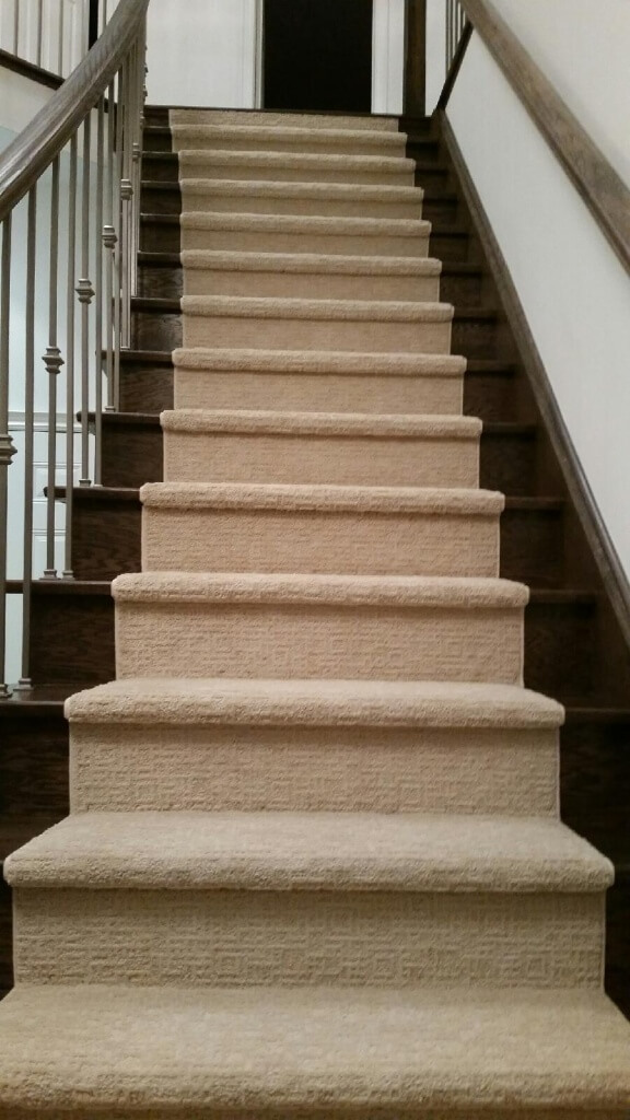 Staircase with carpet center
