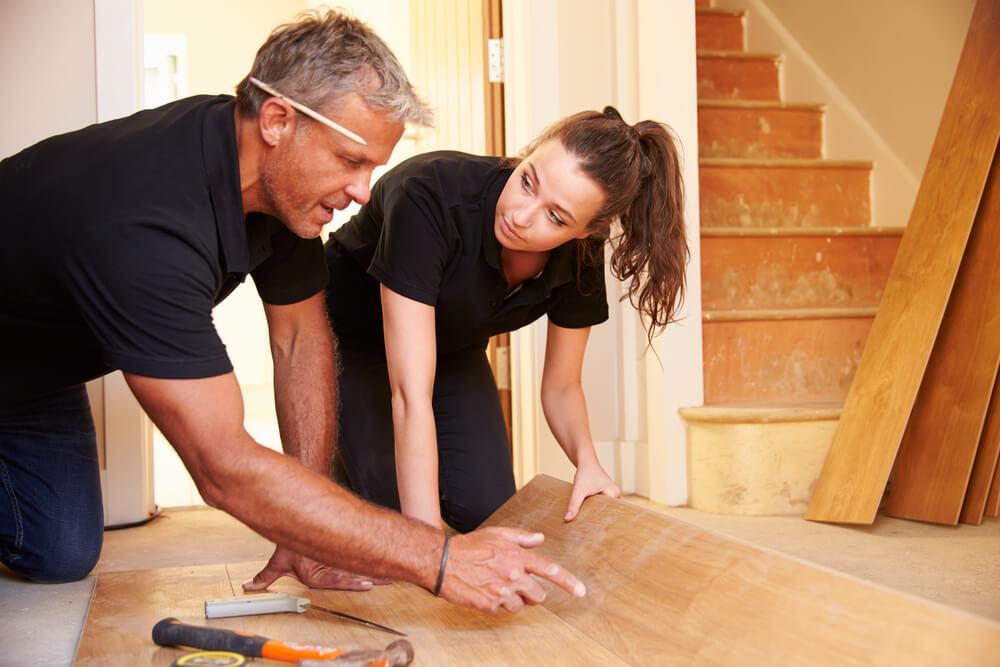 Flooring Installers installing hardwood flooring